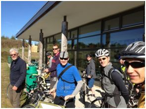 Kent AECB members visiting a straw bale spiral on their bike tour of green buildings