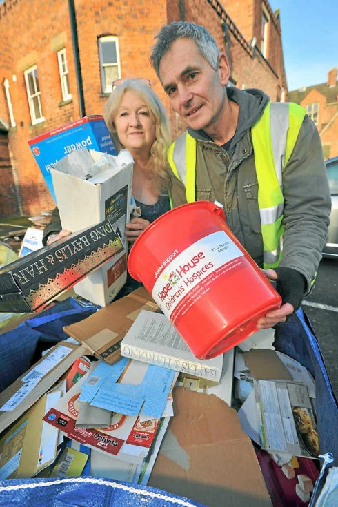 Transition Town Shrewsbury volunteers Margaret Bowman and Howard Hutchings help with the cardboard recycling.  Pic: Shropshire Star.