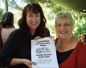 Sonya Wallace (L) and Janet Millington with the Sunshine Coast Energy Descent Action Plan.