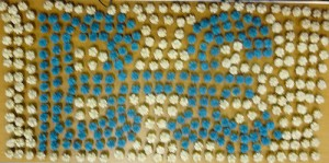 The Brixton Pound symbol made up in small iced cakes